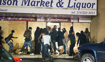 "Film fans in Ferguson, Missouri get some refreshments before watching ""Let's Be Cops"""