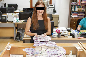 Karen our beautiful anonymous receptionist counts some unwanted bank notes in the office