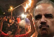 Ferguson-burning-flag-eric-holder