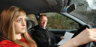 Young woman on driving test lesson