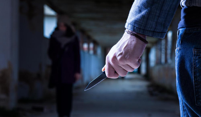 eu criminal-with-knife-waits-for-woman