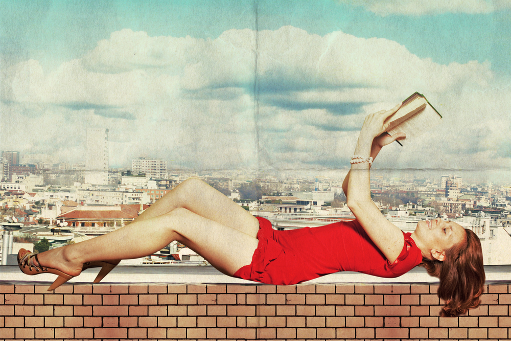 beautiful woman in red dress with book on roof