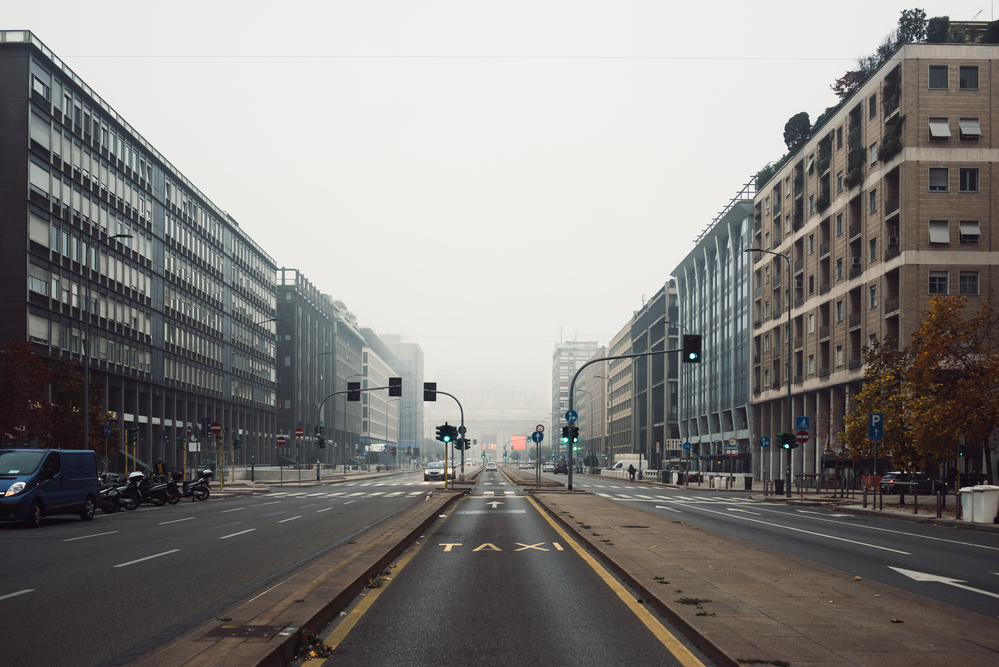 Street front view of Milano Centrale railway station in a foggy