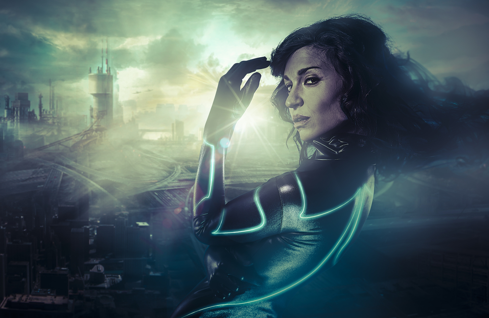 Future woman concept, black latex with neon lights over city 