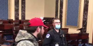 violent insurgent talks calmly to Capitol cop